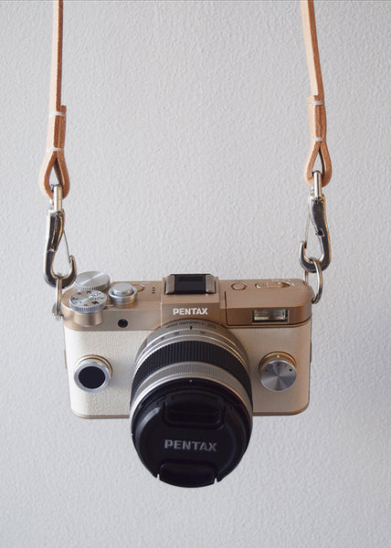 Handcrafted retro style leather camera strap in natural made from vegetable tanned leather in the UK.
