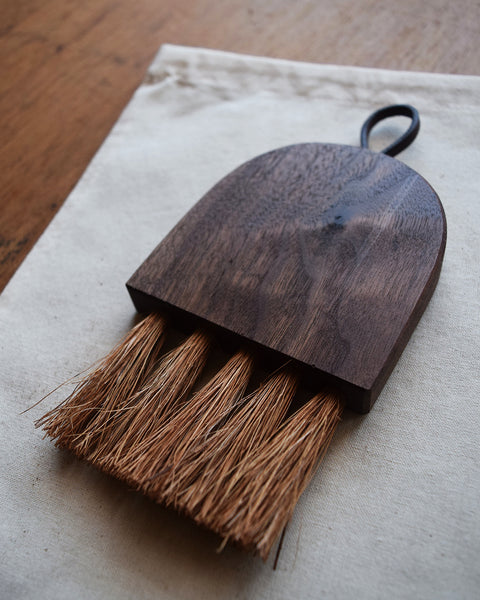 This beautiful small table brush, handcrafted by Hatchet & Bear using reclaimed walnut wood and coconut bristle, is a pleasure to use. We love to sweep breakfast and cake crumbs off our table with this fine little tool.