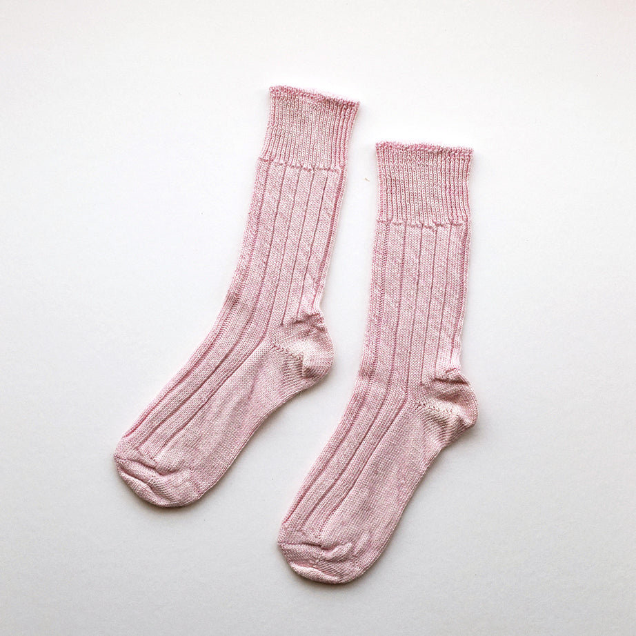 Beautiful soft and cosy Alpaca bed socks in pink perfect for walking around the house or wearing in bed. They have a loose fitting for comfort and they are breathable to resist moisture. These socks have been made in Nottinghamshire by one of the oldest sock manufacturers in the UK using traditional techniques.