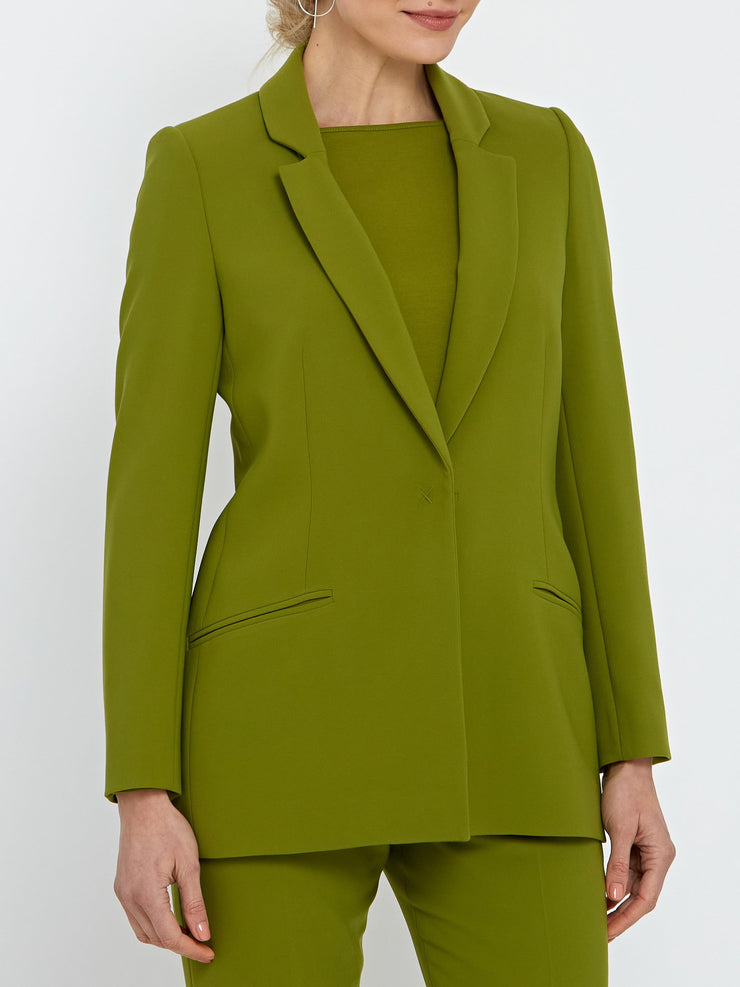 The definitive tux jacket in striking psychedelic green. Minimalist style with a concealed button. Work wear Women.