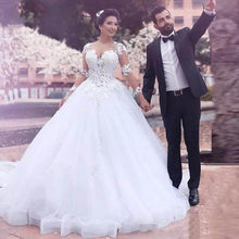 Scoop Ball Gown Wedding Dresses Illusion Back Long Sleeves Lace Appliques Floor Length Court Train Bridal Gown Dress 2019