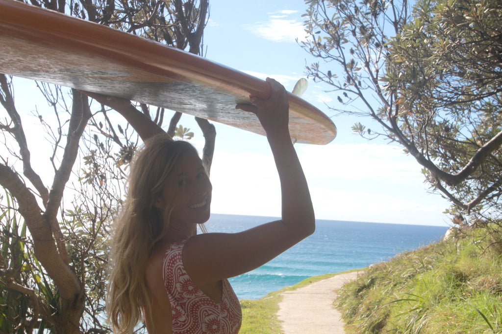 Bing Rider Lauren Hill goes for a surf