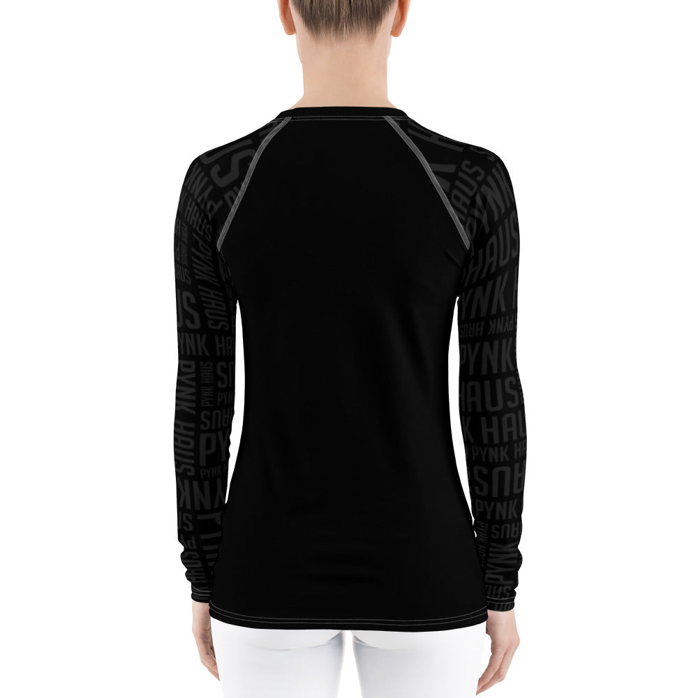 Pynk Haus rash guard in black with faded sleeves