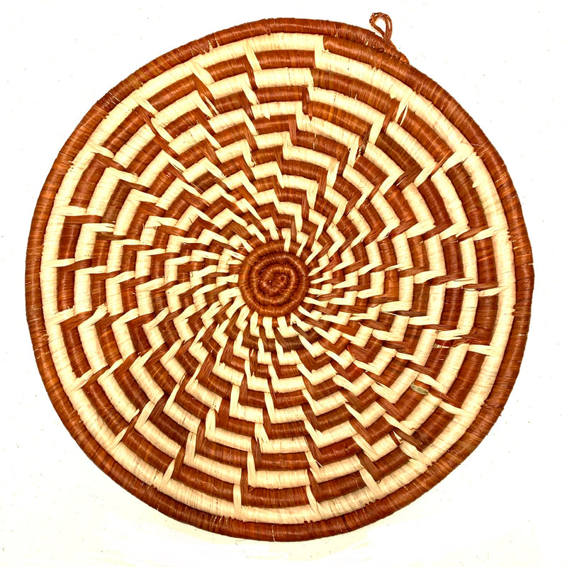 brown and cream woven trivet fair trade made by acid attack survivor from Uganda for sale by nonprofit RISE