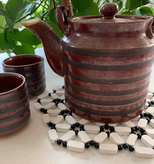 black and white trivet fair trade made by acid attack survivor from Uganda for sale by nonprofit RISE