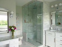 White marble bathroom with steam shower.