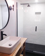 Basement bathroom with marble niche tile.