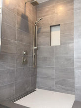 Large format wall tile with niche.