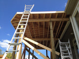 Framing for screened-in porch addition to house.