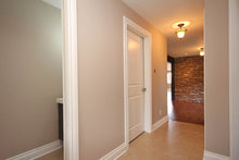 Front entrance to basement with ledge rock accent wall