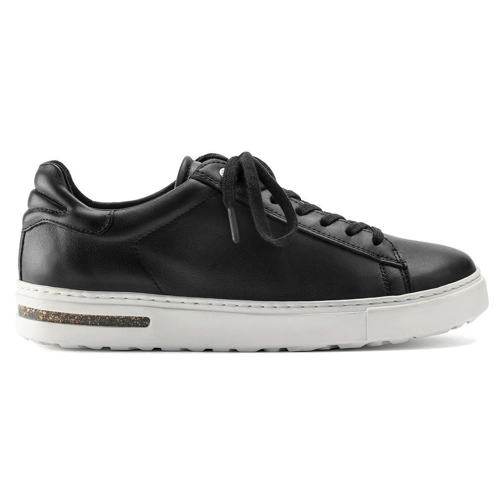 Black leather lace up sneaker with white sole.