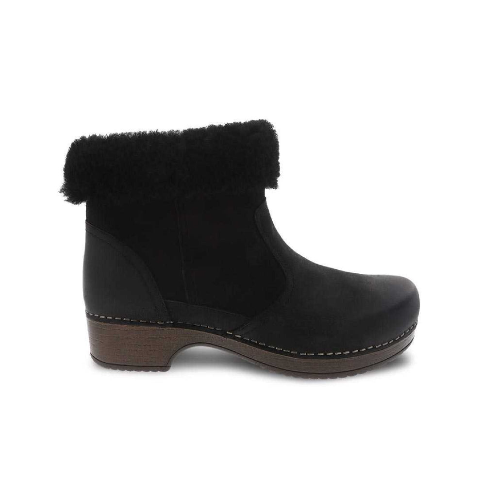 Black Shearling lined boot with brown sole.