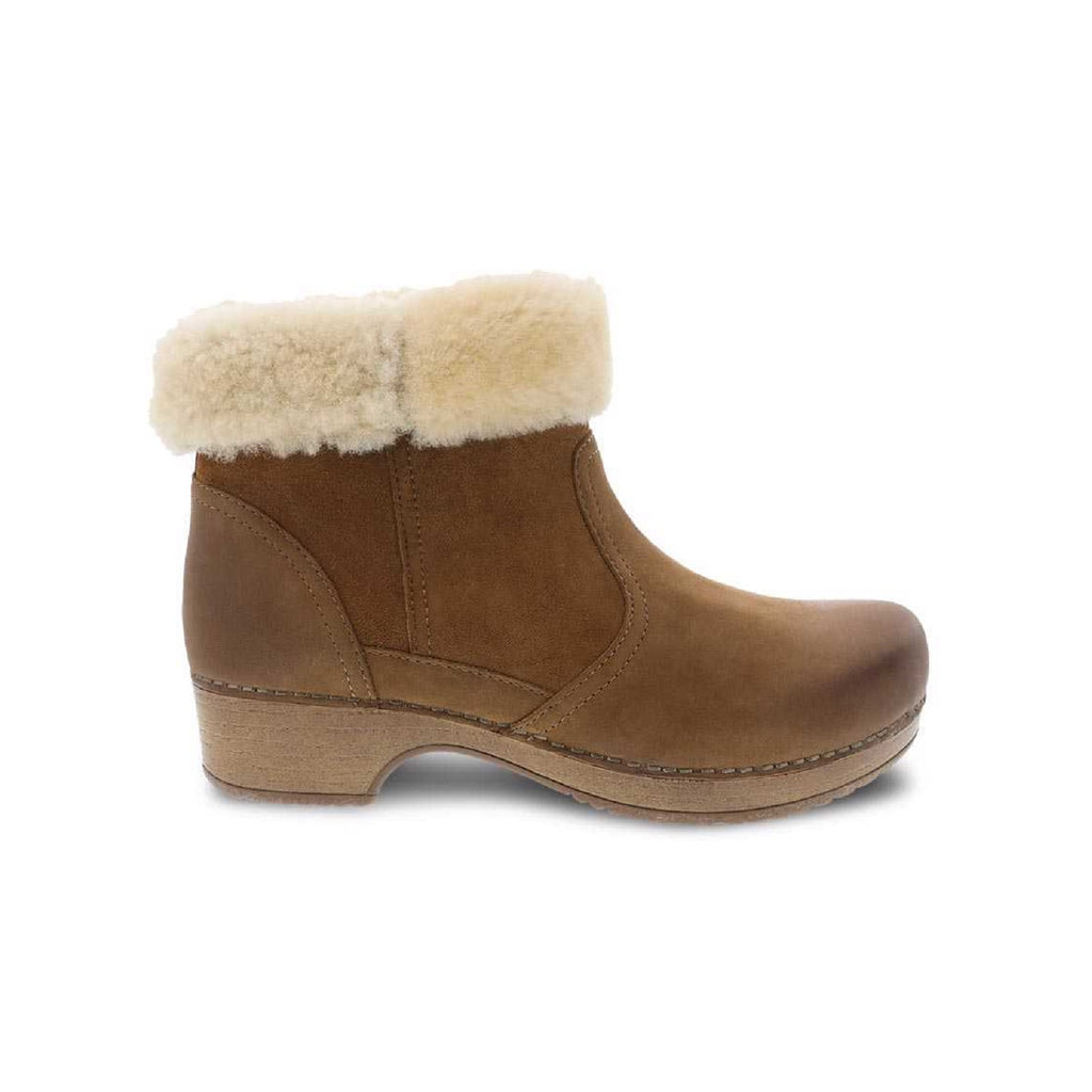 Honey shearling lined boot with brown sole.