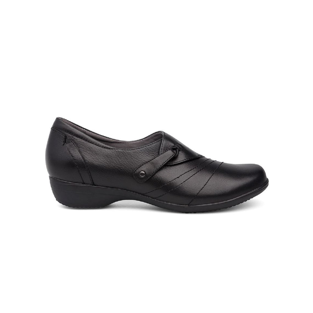 Black loafer with slight heel and adjustable loop.