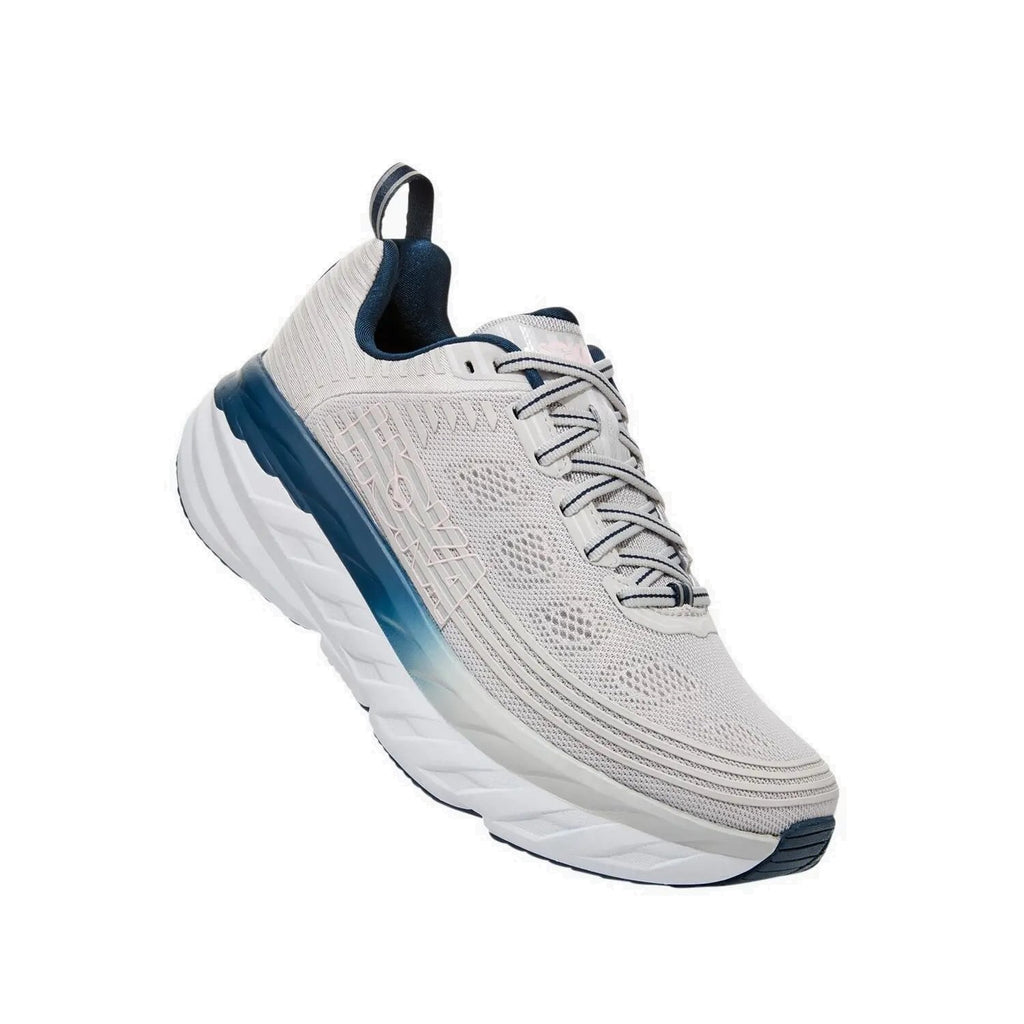 Hoka running shoe with white base and blue accents.