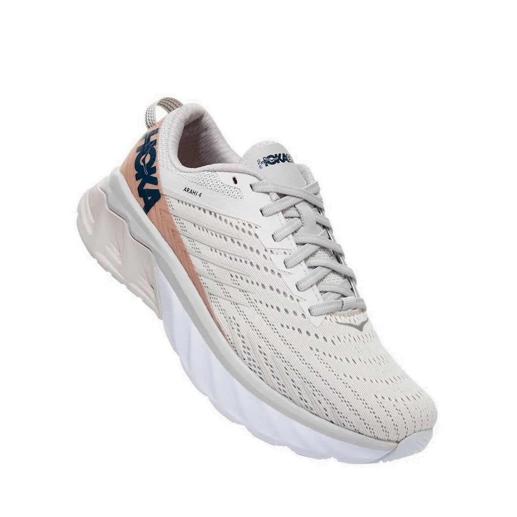 Hoka running shoe with white base and pink accents.