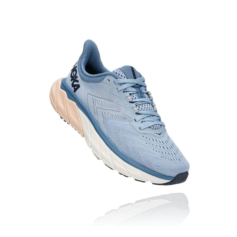 Women's lace up running shoe in light blue with accents of pink and white.