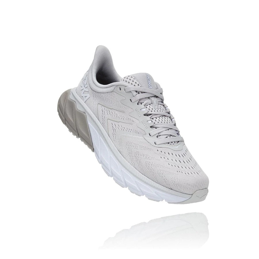 Women's lace up running shoe in grey/white.