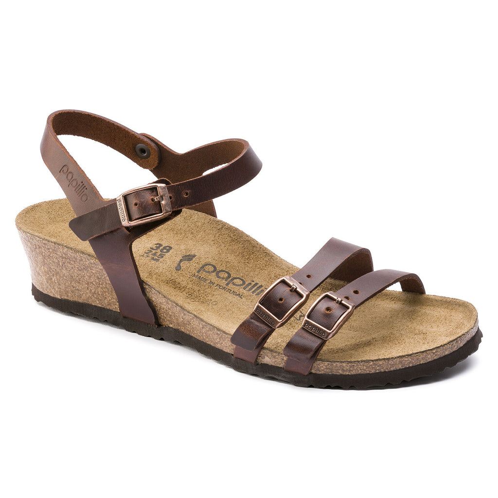 Birkenstock Papillio Lana low wedge heel sandal with leather straps. Color is cognac.