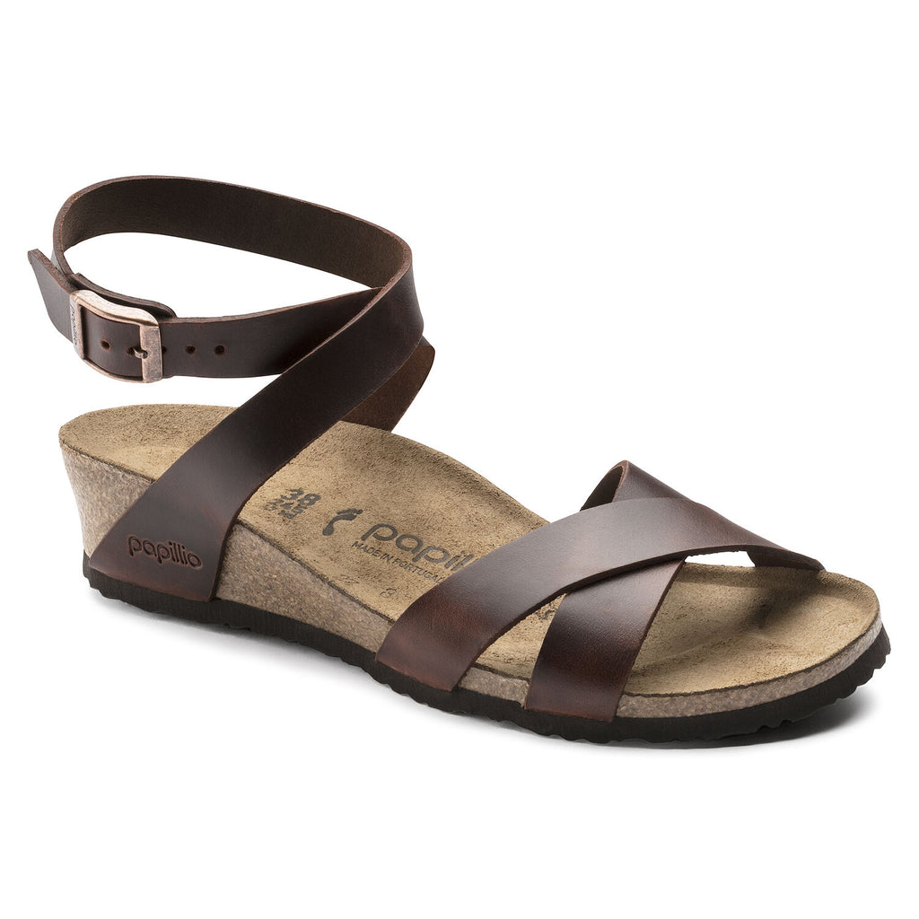 Birkenstock Papillio Lana low wedge heel sandal with leather straps and ankle buckle. Color is cognac.