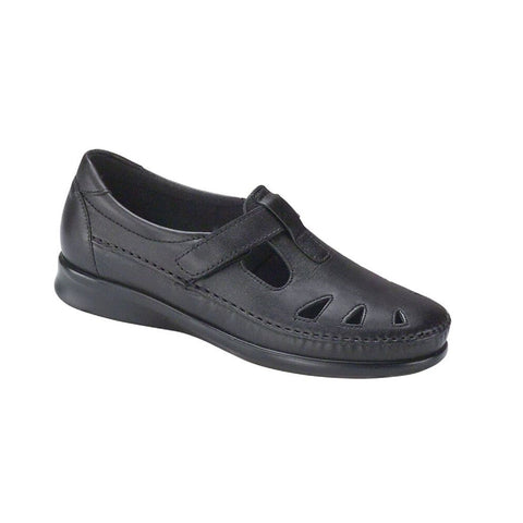 Black loafer with cut out design and velcro strap.