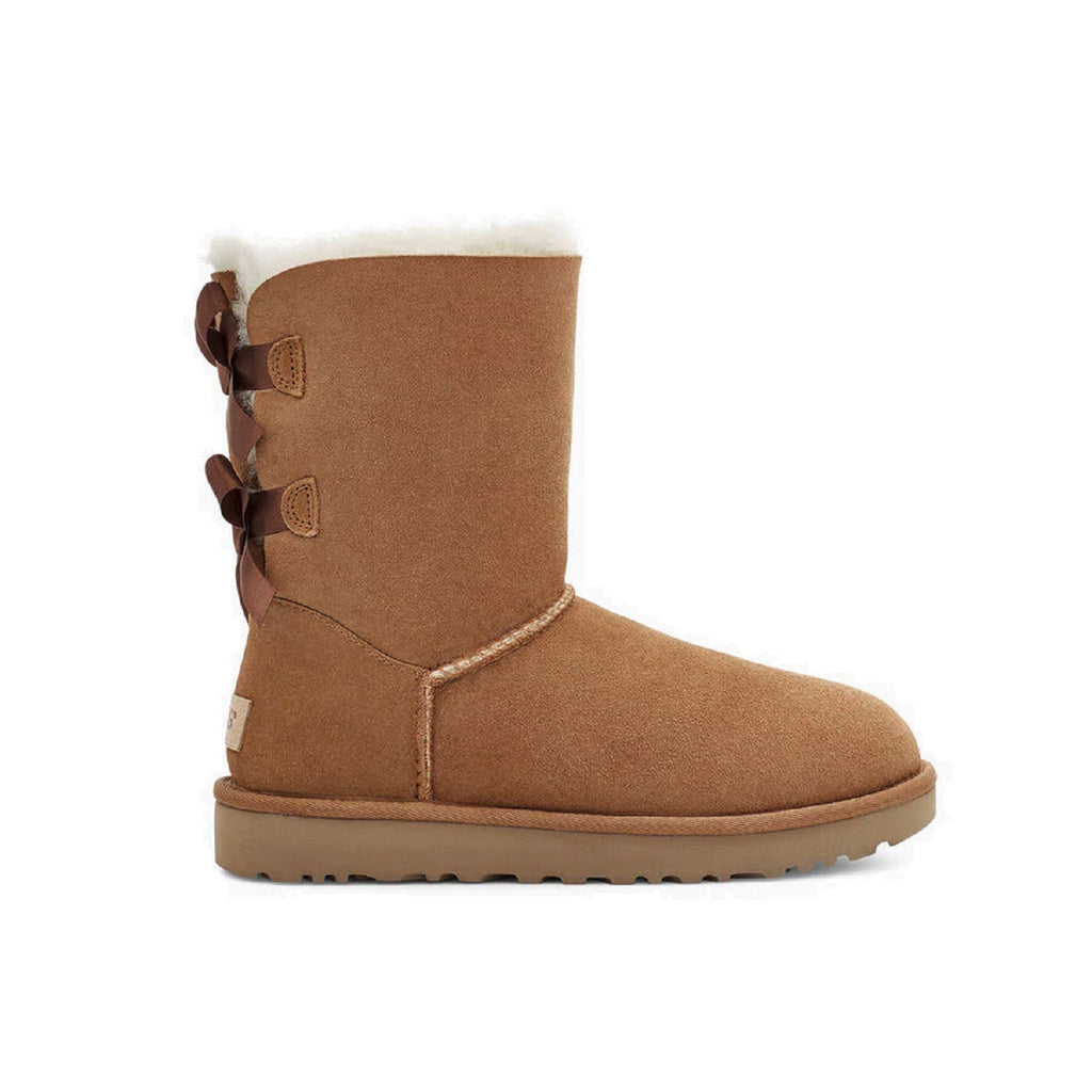 Ugg boot with two bows on the back and sheepskin lining inside. Color is chestnut.