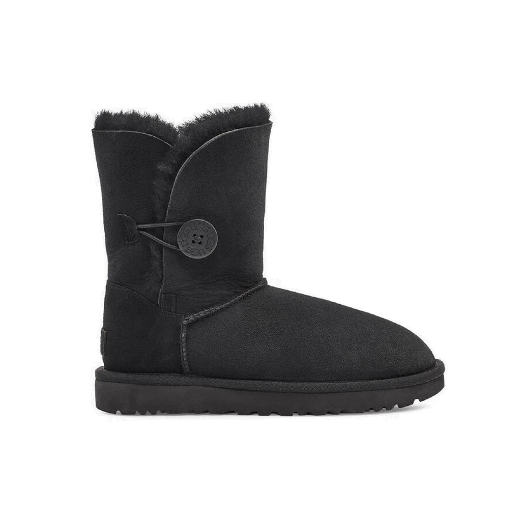 Ugg boot with button on the side and sheepskin lining inside. Color is black.
