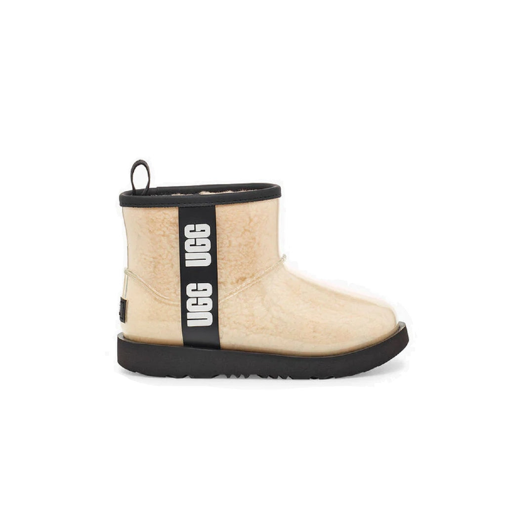 Clear natural rain boot with sheepskin lining.
