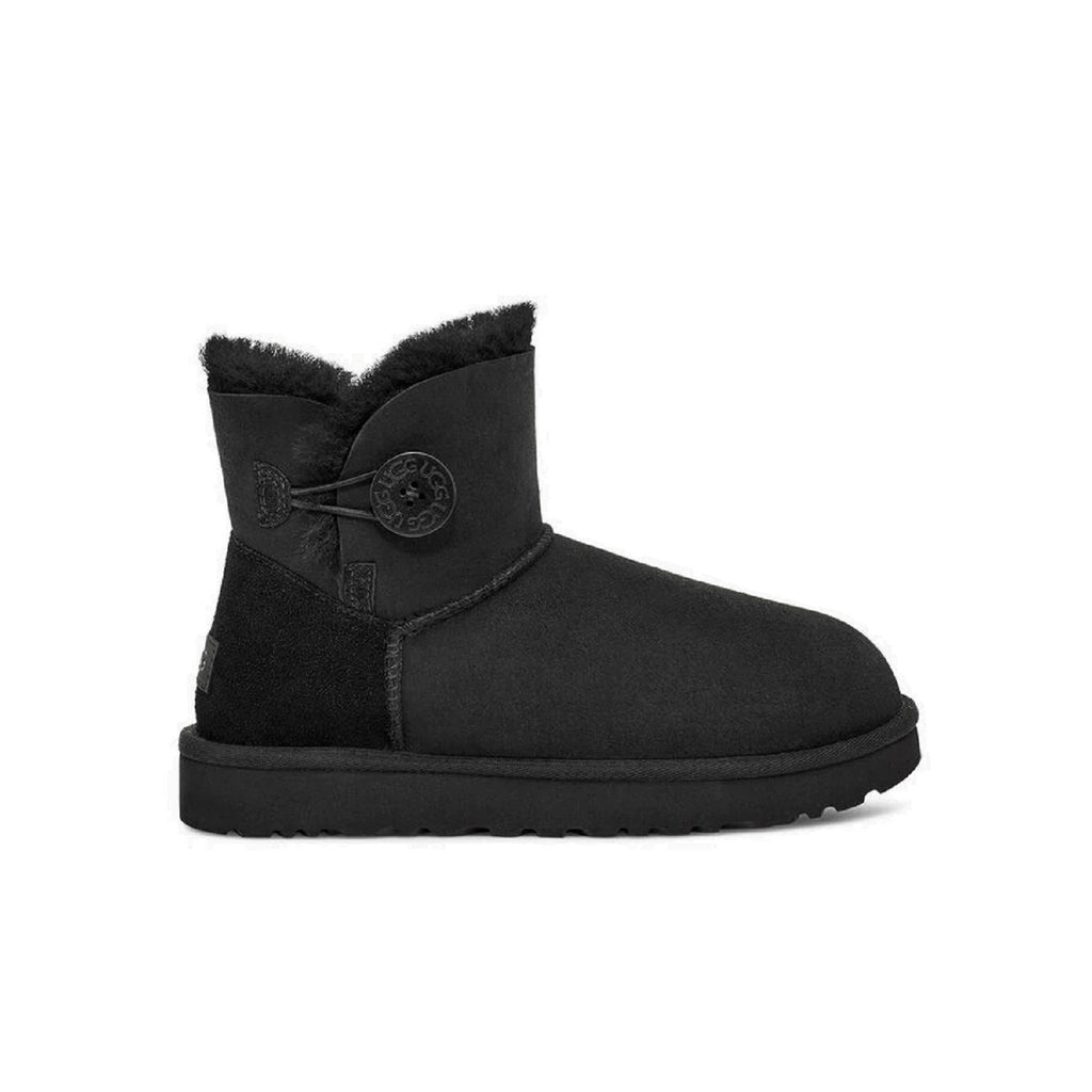 Ugg mini boot with button on the side in black.