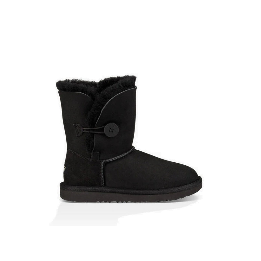 Kid's Ugg boot with button on the side in black.