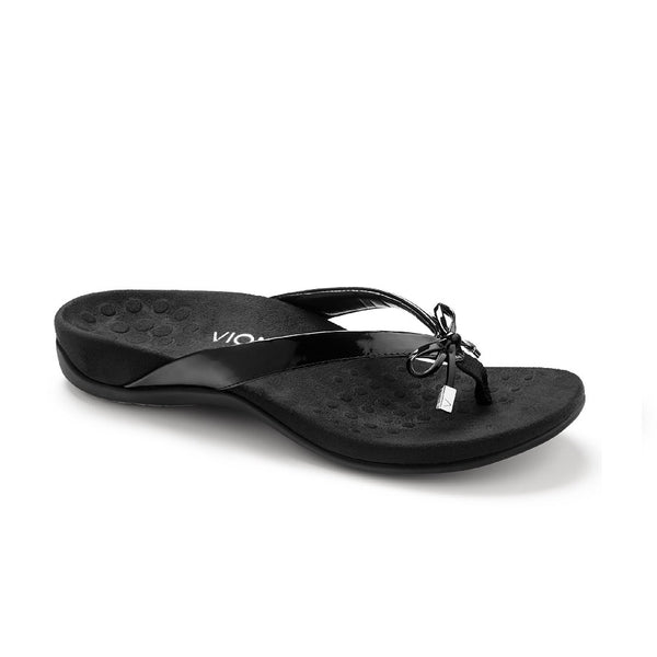 Black flip flop with microfiber lining and bow detail.