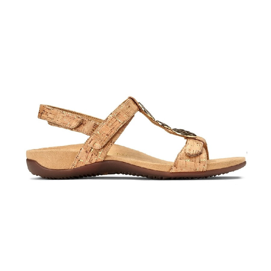 Gold cork sandal with triple strap adjustments and gold embellishments.