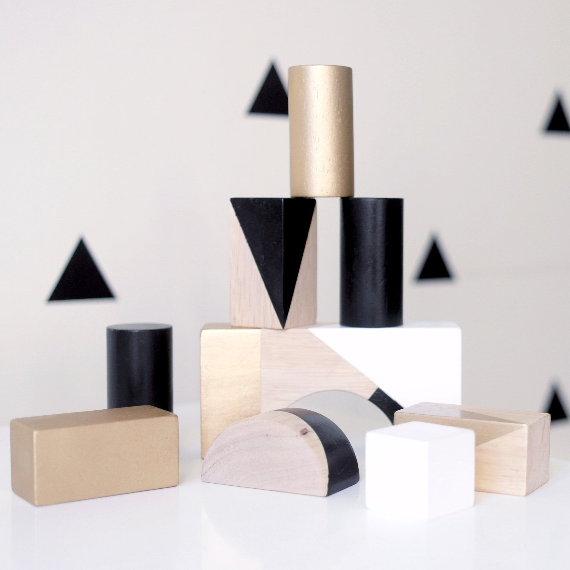 Painted wooden blocks in black, white & gold