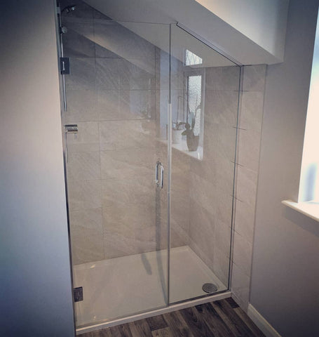 Attic'loft shower glass enclosure, hinged door and fixed panel with U Channel