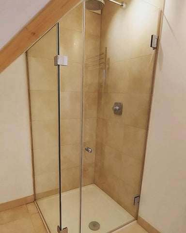 Bespoke shower glass solution for attic with corner tray