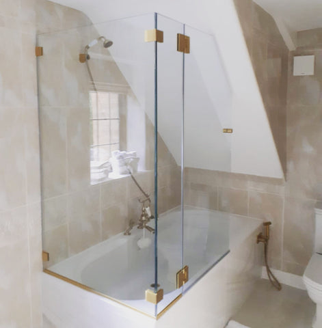 Over bath custom glass enclosure with satin brass components
