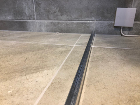 U Channel in position on the floor, ready for the shower glass