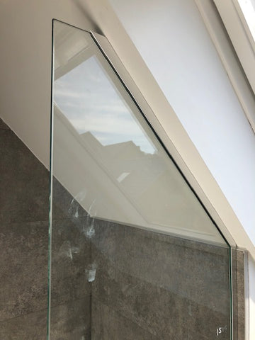 Glass panel in place with U Channel for angled ceiling
