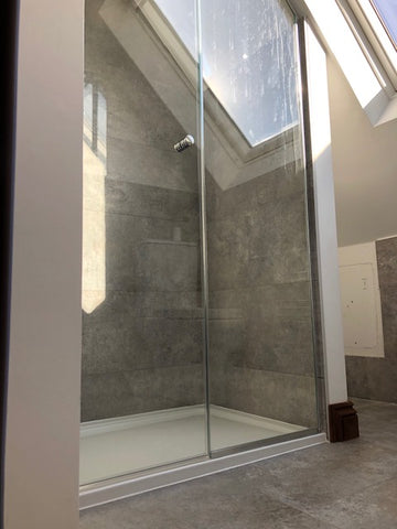 Glass shower enclosure for attic