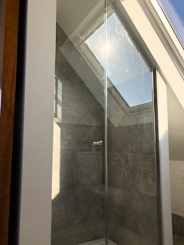 Slanted ceiling shower door and glass panel