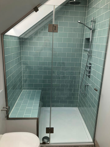 Sloped glass shower glass with glass hung door