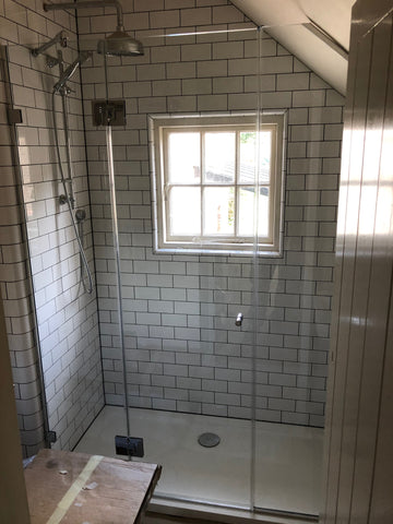 Three panel custom shower set up for sloped ceiling