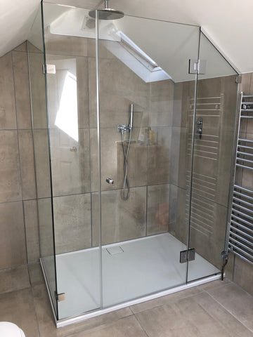 Multi sided glass shower enclosure