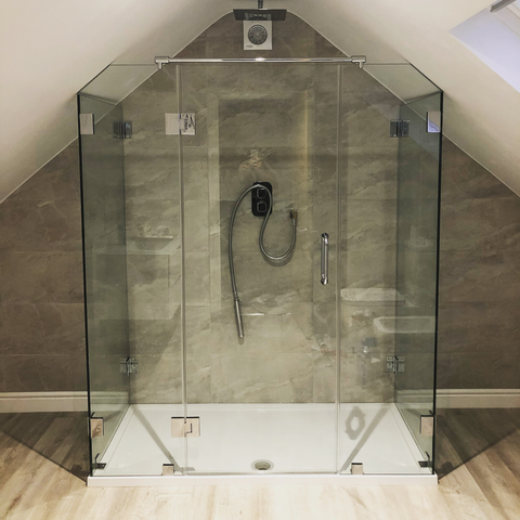 Three sided glass shower enclosure
