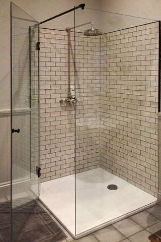 Shower enclosure with black components and support bar