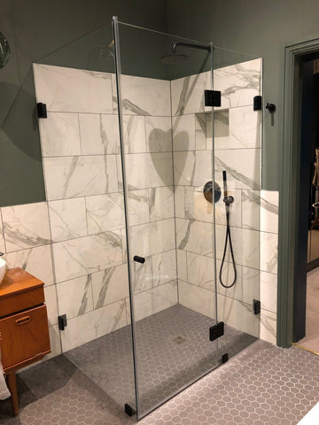 Bespoke glass shower enclosure with matte black hardware