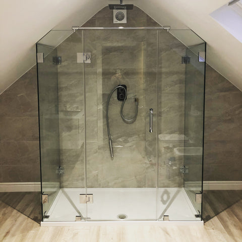 Multi sided shower glass enclosure with angled ceiling panels