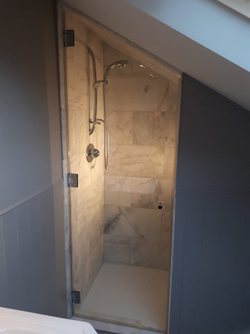 Three wall to glass hinges are used on a glass shower door