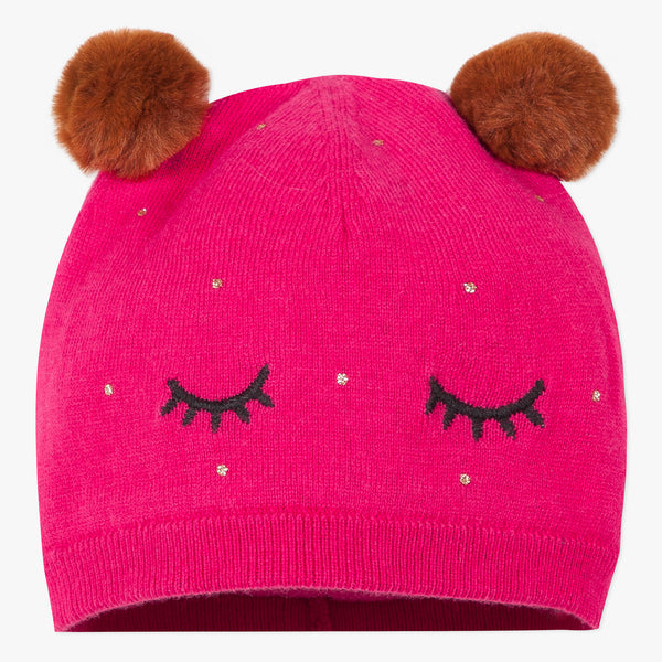 Fuchsia pink knit hat with pompoms