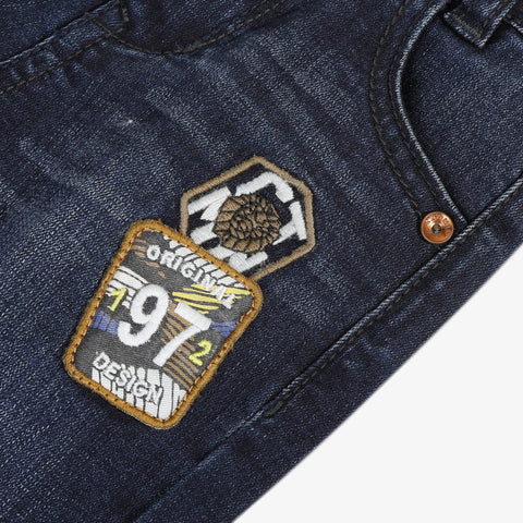Dark slim denim pants with patches